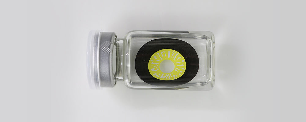 Black and Yellow 22mm sclera contact lenses which entirely cover the sclera and iris